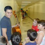 Joshua Nakazama with students