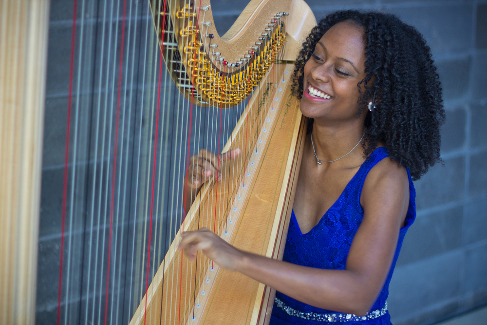 Arts Leadership grant winner Angelica Hairston plays her harp