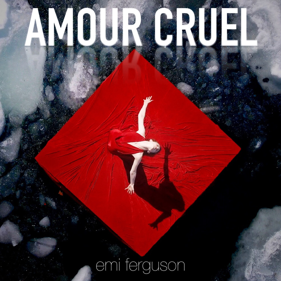 A young woman stands with arms flung wide, and upper body bowed back. She is wearing a bright red gown that flows around her, and forms a diamond on the ground. The words AMOUR CRUEL are in white at the top of the image.