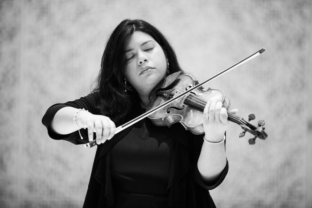 Arts Leadership grant winner Karen Cueva plays her violin