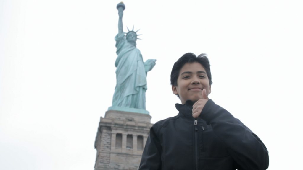 Oscar Paz-Suaznabar at the Statue of Liberty