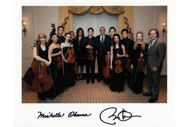 The musicians standing with the President and First Lady