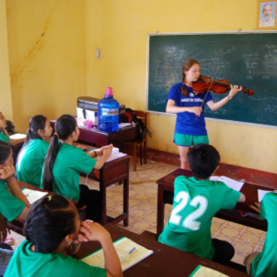 Devon performs for students in Vietnam, modeling how hard work can pay off in the long run.