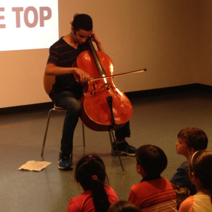 Cellist Lev Mamuya performing last year at the Boston Children's Museum