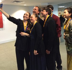 Mark and Maggie O'Connor take selfies with young performers.