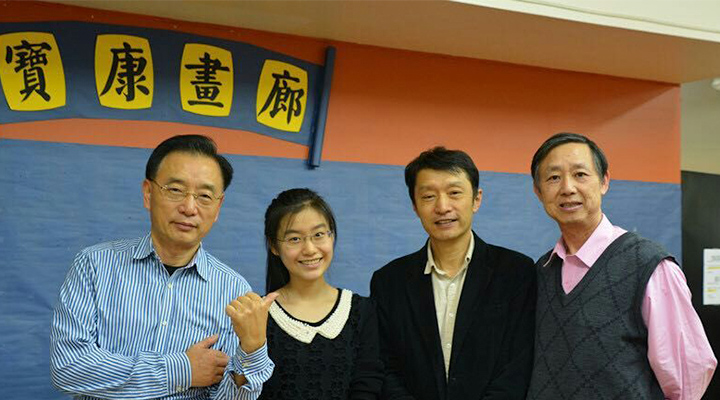 Youlan with her dad Jie Ji, the center's owner Baoli Zhang, and Weixiong Li